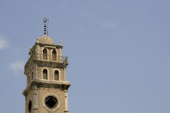 Minaret against blue sky Stock Images