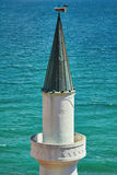 Minaret against the Sea Background Royalty Free Stock Photography