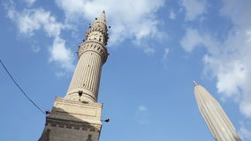 Minaret of al-Hussein Mosque, pan right, Cairo, Egypt stock footage