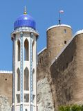 Minaret of Al Khor Mosque and Al Mirani Fort, Muscat. Al Mirani Fort was built in 1550 by the Portuguese in an effort to defend Muscat against the frequent royalty free stock photography