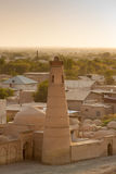 The minaret and the ancient city of Khiva at sunset Stock Photo