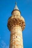 Minaret av den Camii moskén, Konak fyrkant, Izmir, Turkiet Royaltyfri Bild