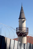 Minaret with barbed wire fence Royalty Free Stock Images