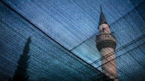 Minaret behind of fabric. Minaret  scene behind of  transparent bazaar curtain in Selcuk, Turkey Royalty Free Stock Photo