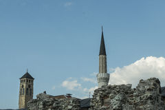 Minaret and bell tower Stock Images