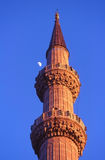 Minaret of the Blue Mosque with the moon, Istanbul Royalty Free Stock Photos