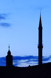 Minaret and church towers Stock Photos