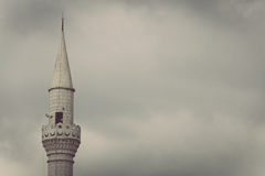 Minaret on cloudy sky Royalty Free Stock Photography