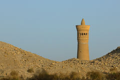 Minaret and desert sand royalty free stock photos
