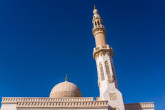 The minaret and the dome of the Maharba mosque Royalty Free Stock Photo