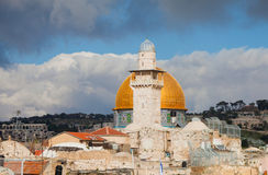 Minaret and Dome of the Rock against cloudy sky Stock Images