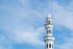Minaret and dome of Tengku Tengah Zaharah Mosque with blue sky background. Beautiful architecture, minaret and dome of Tengku Tengah Zaharah Mosque with blue sky Royalty Free Stock Image