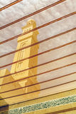 Minaret  in Dubai viewed through the inside of the mosque window Royalty Free Stock Photos