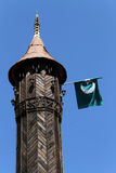 Minaret and flag Royalty Free Stock Photos