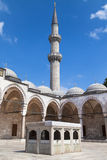 Minaret and fountain of Suleymaniye Mosque Stock Image