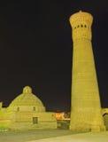 The minaret. The Great Minaret (Kalyan Minaret) is especially beautiful in bright evening illumination, Bukhara, Uzbekistan stock photos