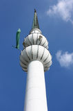 Minaret with green flag Stock Photos