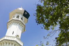 Minaret with islamic flag. In a Mosque in Georgetown, Malaysia Stock Images