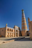 Minaret in Khiva. Beautiful tall minaret in Khiva, Uzbekistan royalty free stock image