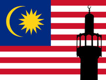 Minaret in Malaysia. Minaret of mosque against Malaysian Flag Royalty Free Stock Photography