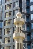 Minaret and modern facade Stock Photos
