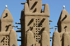 Minaret of a mosk made of mud in Mali. Minaret of a traditional mosk made of mud in Mali, West Africa Stock Photo