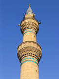 The minaret of the mosque. And blue sky Royalty Free Stock Images