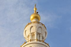 Minaret of the mosque against blue skies. Minaret of the Sheikh Zayed Grand Mosque against blue skies in Abu Dhabi, UAE Royalty Free Stock Photography