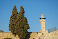 The minaret of mosque of Al Aqsa and wall. The tower of Al-Aqsa Mosque in Old City of Jerusalem, Israel Royalty Free Stock Images