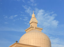 Minaret of a mosque with blue sky background Stock Images