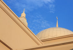 Minaret of a mosque with blue sky background Royalty Free Stock Photo