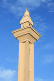 Minaret of a mosque with blue sky background Royalty Free Stock Image