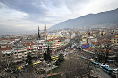 Minaret, mosque and houses of Bursa, Turkey. (Clouds Sky Royalty Free Stock Image