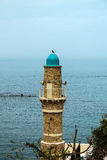 The minaret of the mosque in old Jaffa   on blue sky and  Mediterranean sea background Stock Photo