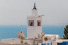 Minaret of Mosque of Sidi Bou Said on background Mediterranean Sea, Tunisia stock images