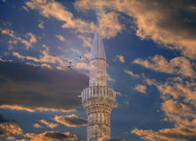 Minaret Of Mosque at sunset Royalty Free Stock Photo