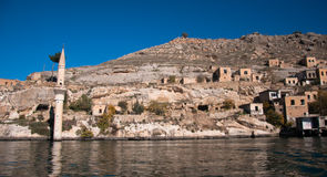 Minaret of the mosque in the water in village near Halfeti Royalty Free Stock Photography