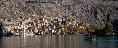 Minaret of the mosque in the water in village near Halfeti Royalty Free Stock Photos