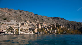 Minaret of the mosque in the water in village near Halfeti Royalty Free Stock Image