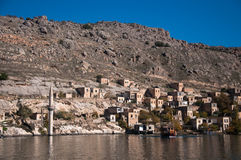 Minaret of the mosque in the water in village near Halfeti Royalty Free Stock Photo