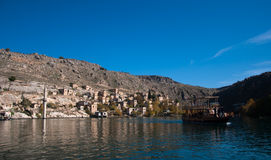 Minaret of the mosque in the water in village near Halfeti Stock Photos