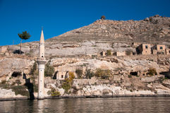 Minaret of the mosque in the water in village near Halfeti Stock Image