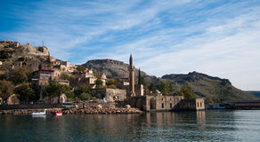 Minaret of the mosque in the water in village near Halfeti Royalty Free Stock Images