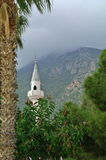 Minaret and mountain above Kaş, Turke Royalty Free Stock Image