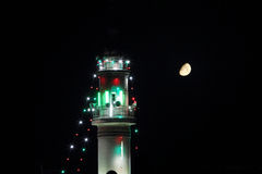 Minaret of old mosque with moon in ramadan Stock Photography