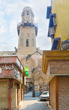 The minaret over the arch. CAIRO, EGYPT - OCTOBER 10, 2014: The entrance of Al Salheyya alley, branching from Al-Moaz street is topped by minaret of Al-Salih Stock Image