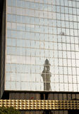 A minaret reflection from a modern building Stock Photography