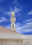 Minaret of Sheikh Isa Bin Ali Mosque on blue sky Royalty Free Stock Photo