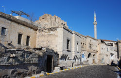 Minaret and the street of old middle eastern town Stock Image