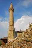 Minaret of Tabacica Mosque in Mostar. Nearby Main Tourist Street Royalty Free Stock Photography